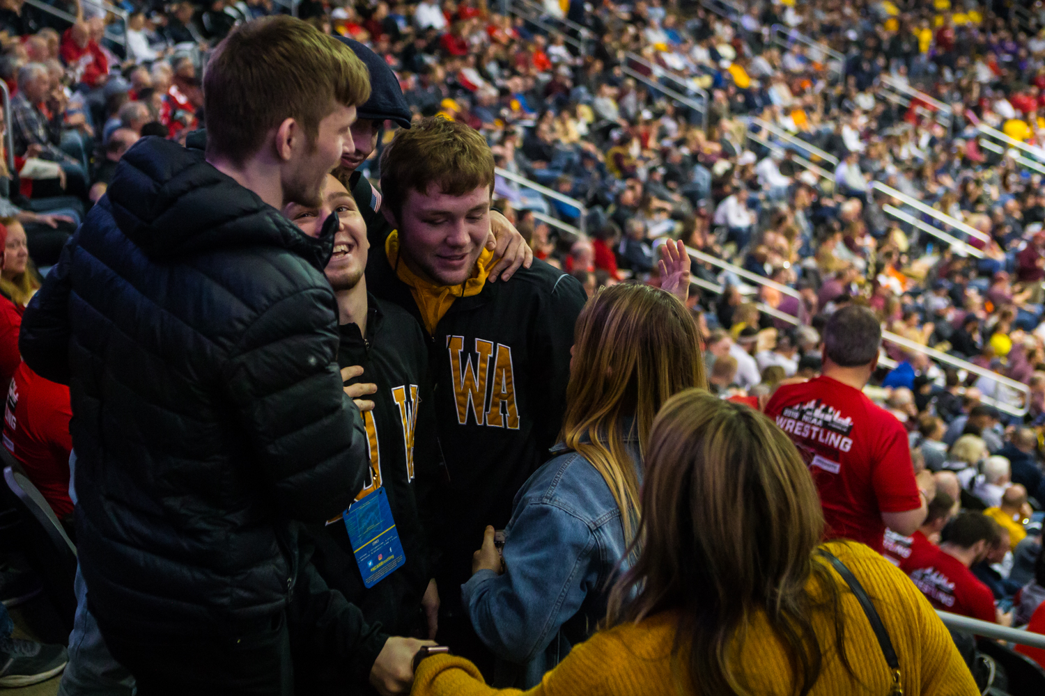 Iowa%27s+Spencer+Lee+celebrates+his+first-place+finish+in+the+125-pound+weight+class+with+teammates+and+friends+during+the+final+session+of+the+2019+NCAA+D1+Wrestling+Championships+at+PPG+Paints+Arena+in+Pittsburgh%2C+PA+on+Saturday%2C+March+23%2C+2019.
