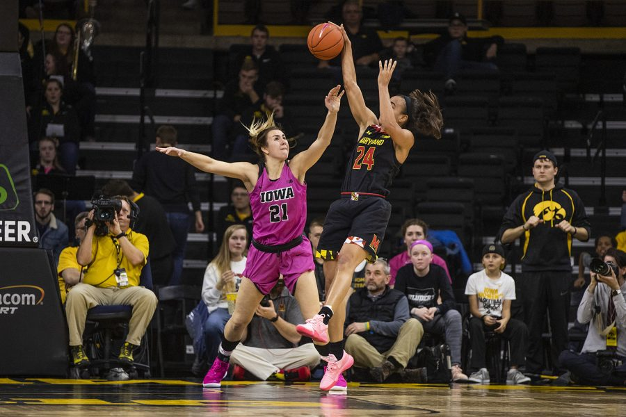 Iowa forward Hannah Stewart (21) guards Maryland forward Stephanie Jones (24) during the women's basketball game vs. Maryland at Carver-Hawkeye Arena on Sunday, February 17, 2019. The Hawkeyes defeated the Terrapins 86-73.