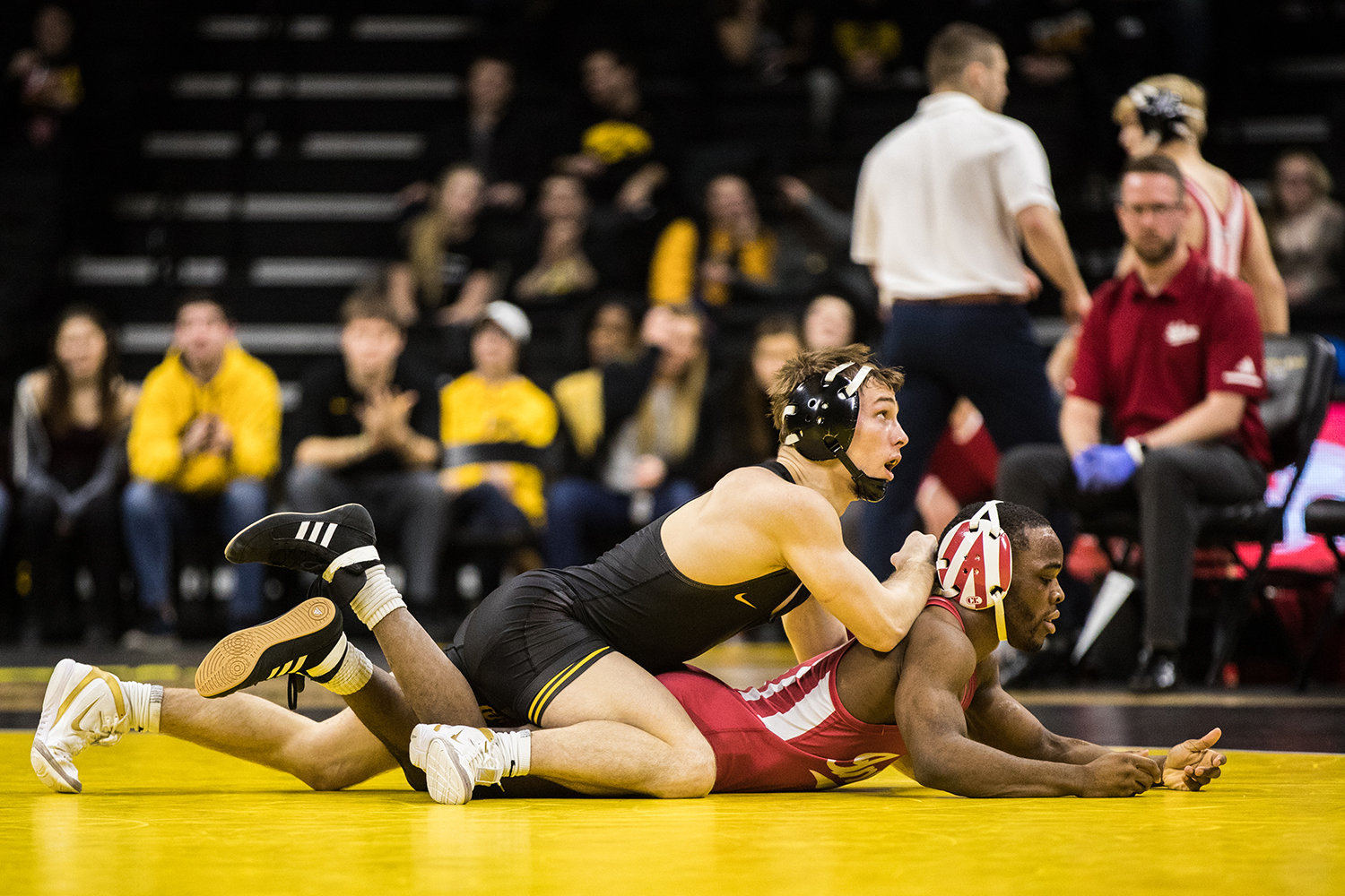 Iowa's No. 2 Spencer Lee wrestles Indiana's Elijah Oliver at 125lb during a wrestling match between Iowa and Indiana at Carver-Hawkeye Arena on Friday, February 15, 2019. The Hawkeyes, celebrating senior night, defeated the Hoosiers 37-9. (Shivansh Ahuja/The Daily Iowan)