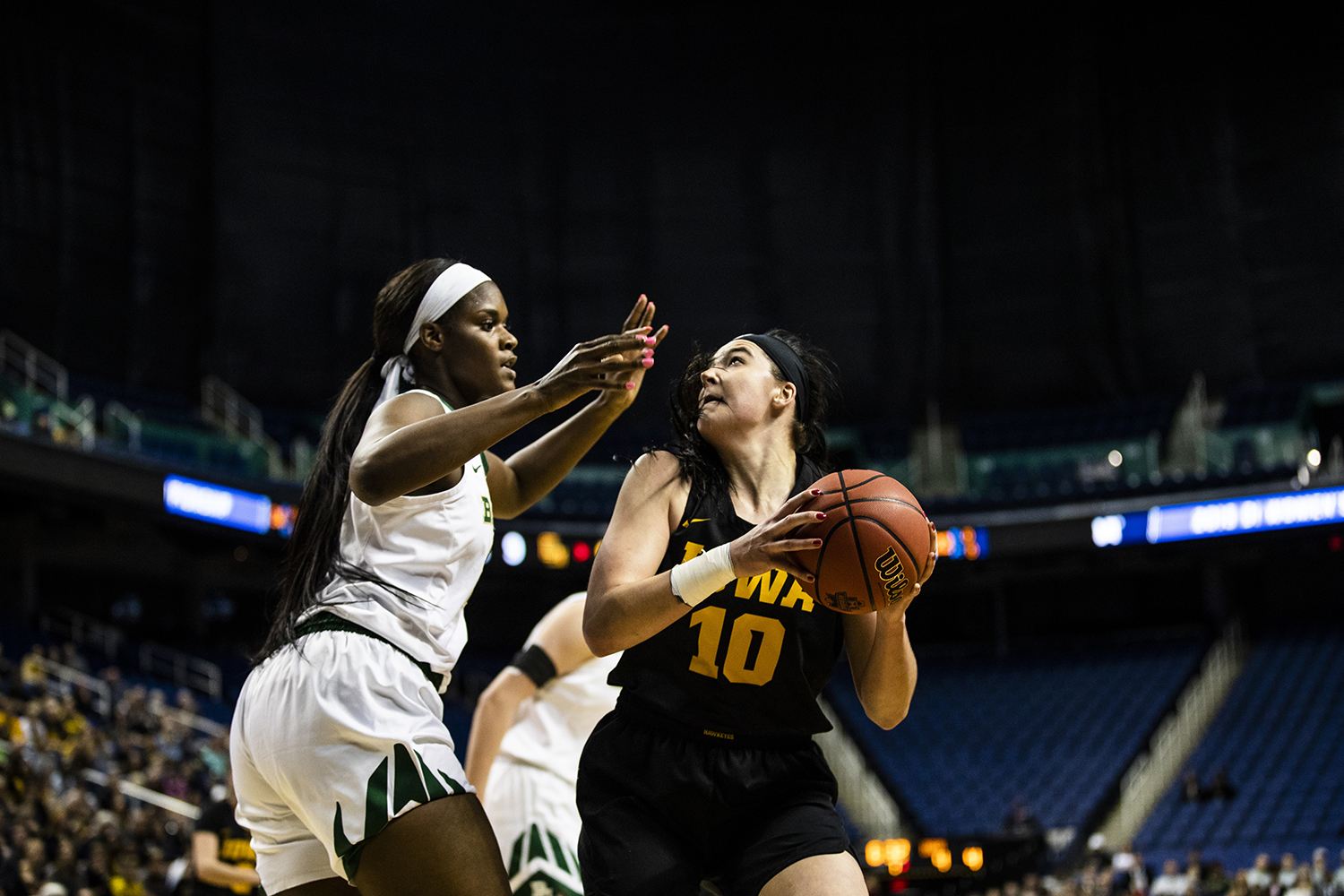 Iowa+center+Megan+Gustafson+prepares+to+shoot+the+ball+past+Baylor+center+Kalani+Brown+during+the+NCAA+Elite+8+game+against+Baylor+at+the+Greensboro+Coliseum+Complex+on+Monday%2C+April+1%2C+2019.+The+Bears+defeated+the+Hawkeyes+85-53.