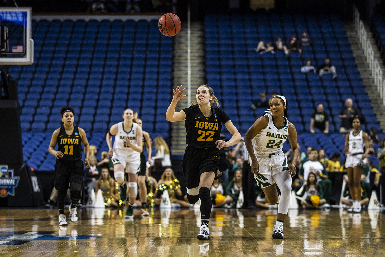 Iowa+guard+Kathleen+Doyle+and+Baylor+guard+Chloe+Jackson+run+for+the+ball+during+the+NCAA+Elite+8+game+against+Baylor+at+the+Greensboro+Coliseum+Complex+on+Monday%2C+April+1%2C+2019.+The+Bears+defeated+the+Hawkeyes+85-53.