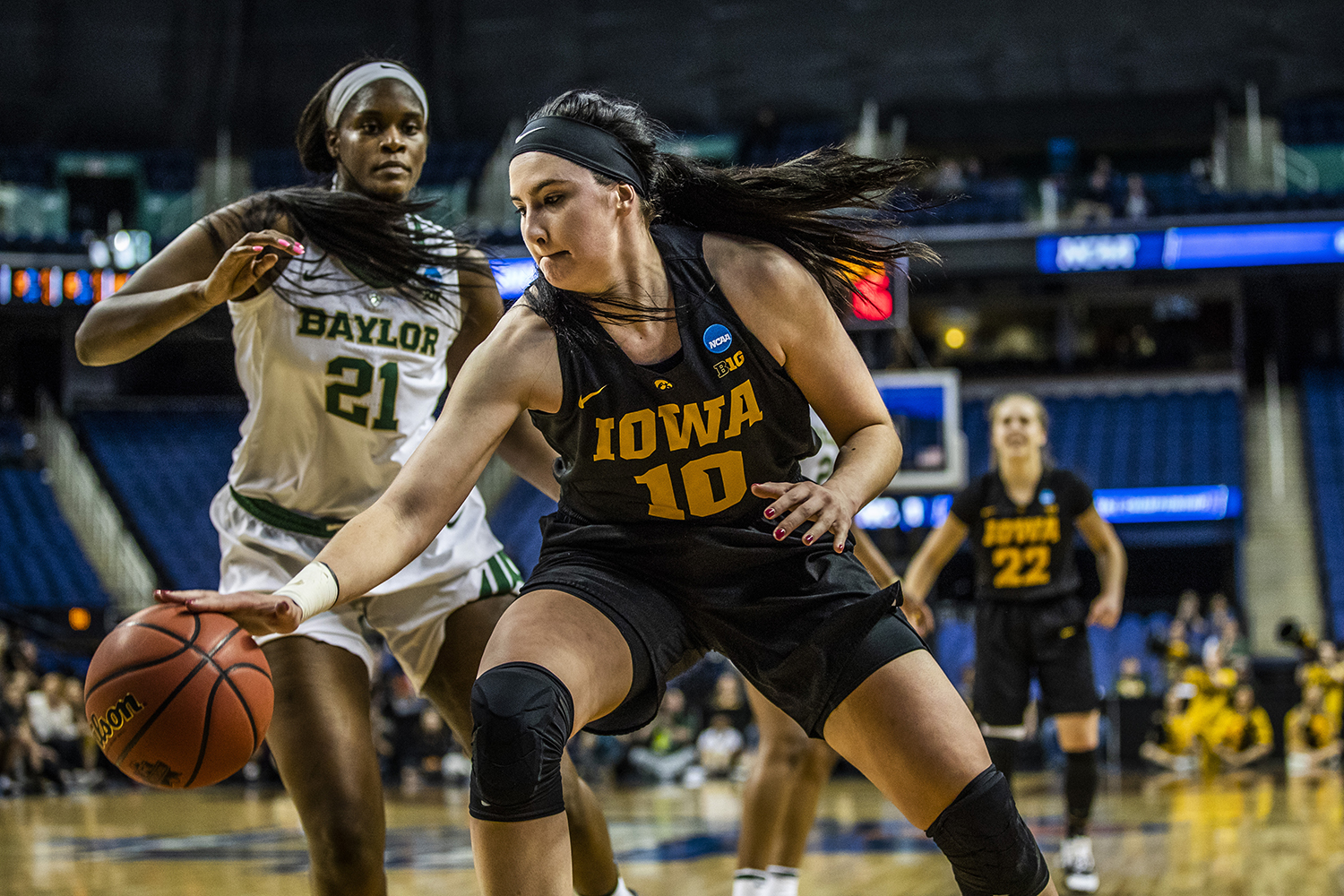 Iowa center Megan Gustafson takes a hold of the ball as Baylor center Kalani Brown runs to guard her during the NCAA Elite 8 game against Baylor on April 1.