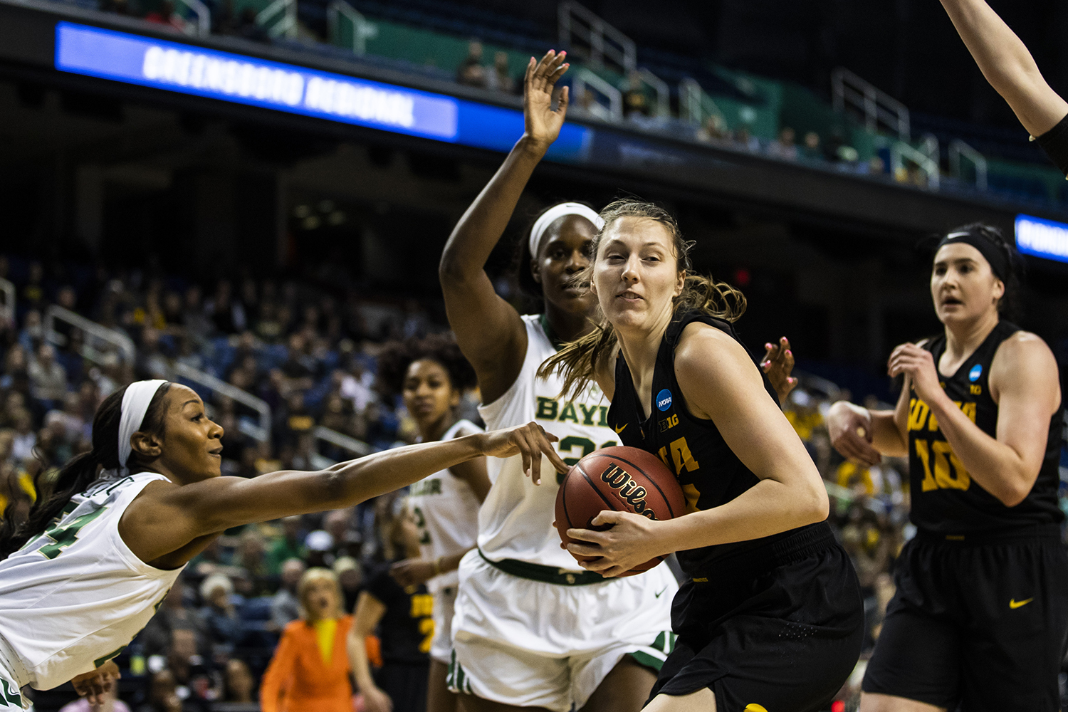 Iowa+forward+Amanda+Ollinger+keeps+the+ball+away+from+Baylor+guard+Chloe+Jackson+during+the+NCAA+Elite+8+game+against+Baylor+at+the+Greensboro+Coliseum+Complex+on+Monday%2C+April+1%2C+2019.+The+Bears+defeated+the+Hawkeyes+85-53.