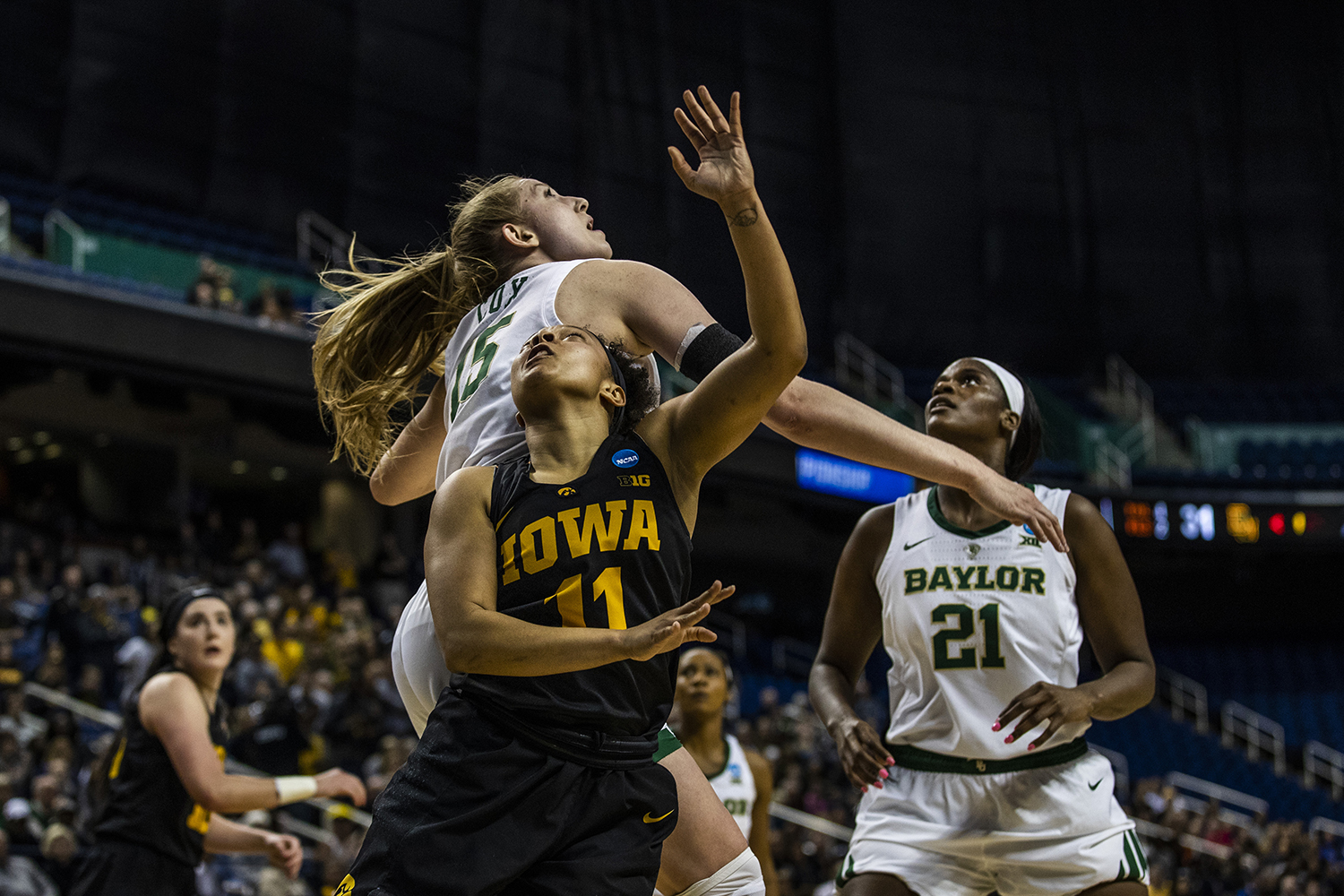 Iowa+guard+Tania+Davis+shoots+the+ball+past+Baylor+forward+Lauren+Cox+during+the+NCAA+Elite+8+game+against+Baylor+at+the+Greensboro+Coliseum+Complex+on+Monday%2C+April+1%2C+2019.+The+Bears+defeated+the+Hawkeyes+85-53.