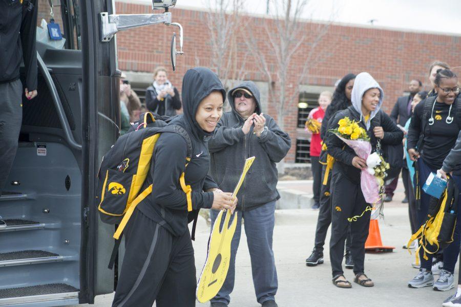 Tania Davis departs the team bus at the Coralville Transit Center on April 2, 2019.