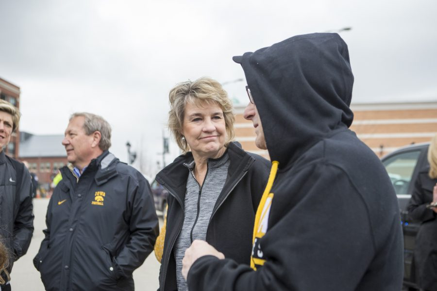 Head coach Lisa Bluder talks to fans as her team departs the bus at the Coralville Transit Center on April 2, 2019.