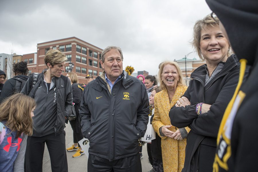 University of Iowa president Bruce Herrald and the Iowa womens basketball coaches talk to a fan on April 2, 2019.