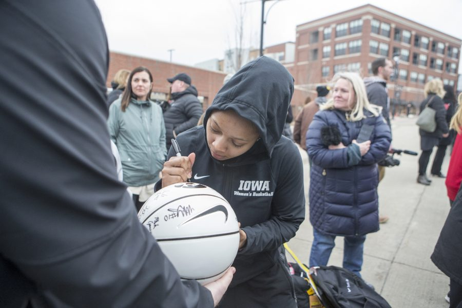 Tania Davis signs a basketball for a fan on April 2, 2019.
