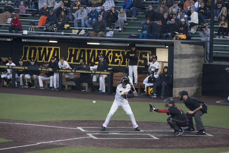 Iowa catcher Austin Martin watches the ball at the Iowa vs Rutgers game at Duane Banks Field on Friday, April 4, 2019. The Hawkeyes defeated the Scarlet Knights 6-1.