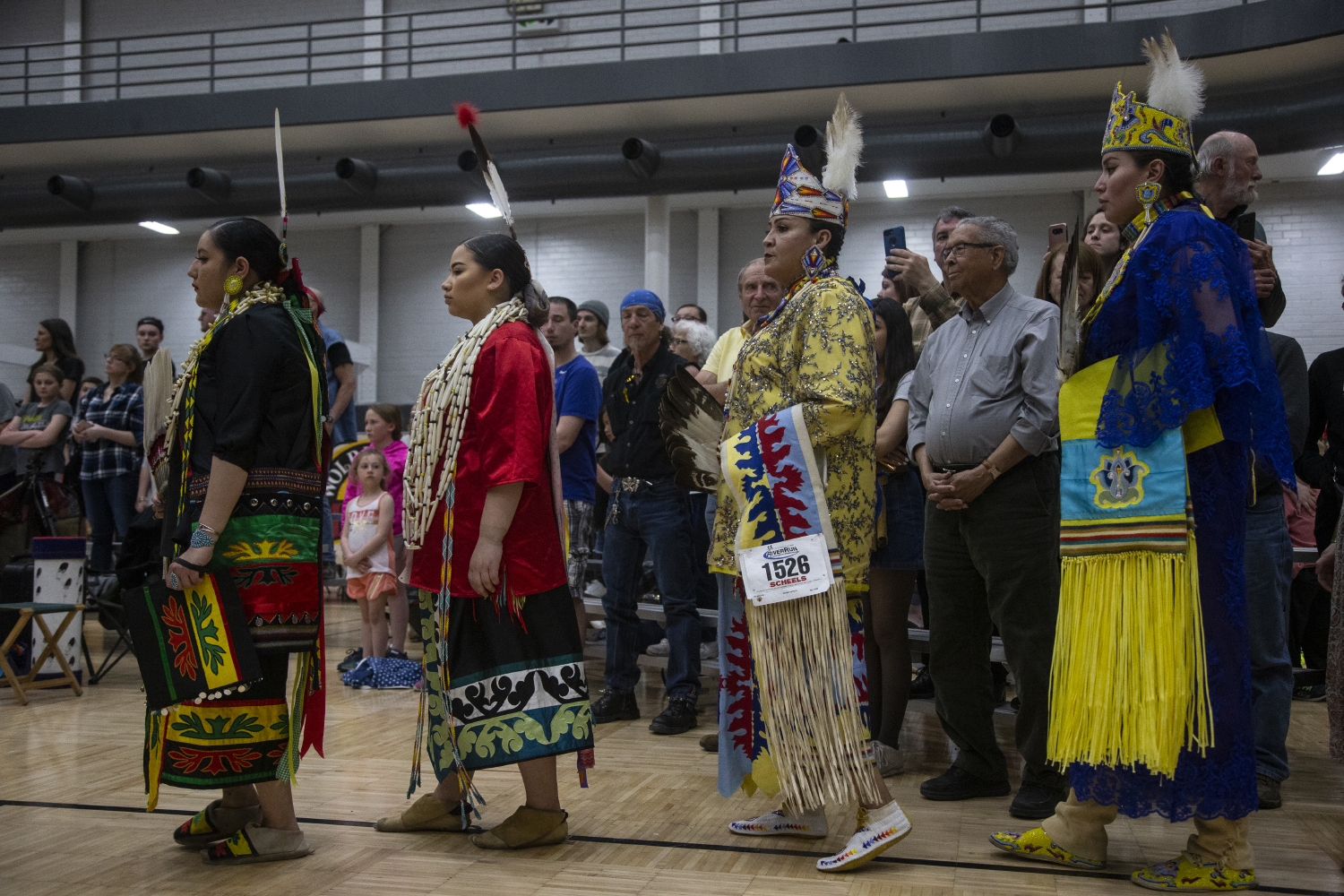 Dancers+perform+in+the+grand+entrance+during+the+25th+annual+University+of+Iowa+Powwow+in+the+Fieldhouse+on+April+20%2C+2019.+Hosted+by+the+Native+American+Student+Association%2C+participants+could+buy+traditional+food+and+clothing%2C+and+sign+up+to+perform+traditional+song+and+dance.