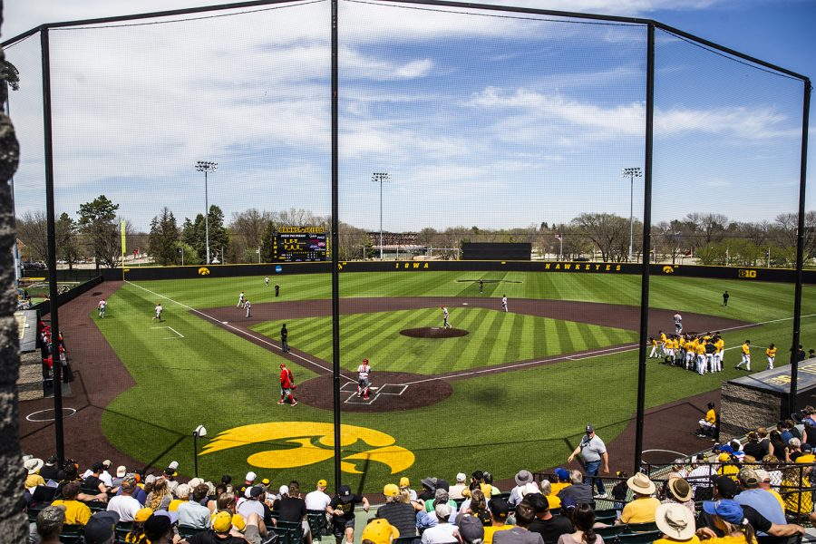 Players prepare to take the field during the baseball game against Nebraska at Duane Banks Field on Sunday, April 21, 2019. The Cornhuskers defeated the Hawkeyes, 3-2.
