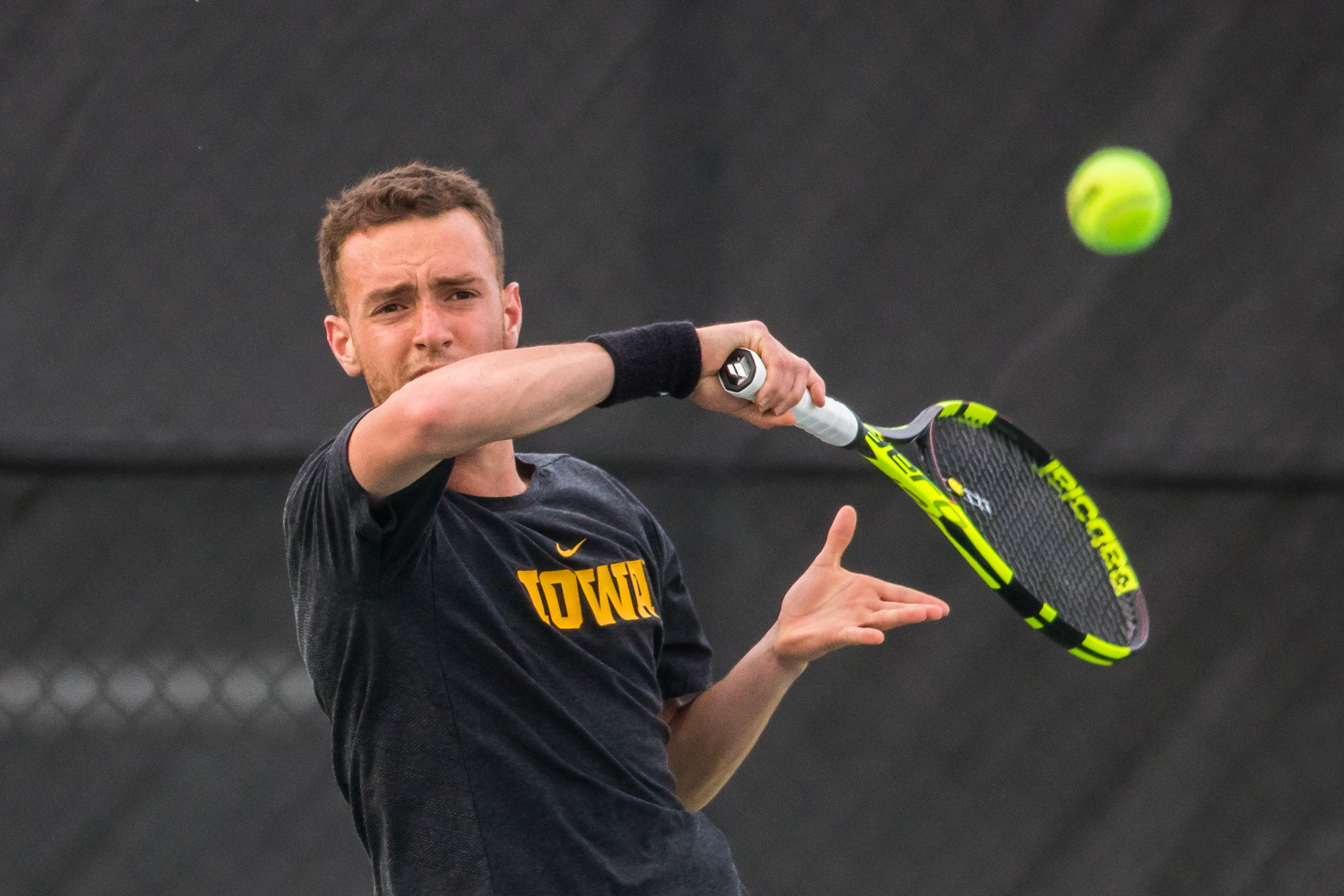 Iowa's Kareem Allaf hits a forehand during a men's tennis match between Iowa and Illinois State at the HTRC on Sunday, April 21, 2019. The Hawkeyes defeated the Redbirds, 6-1.