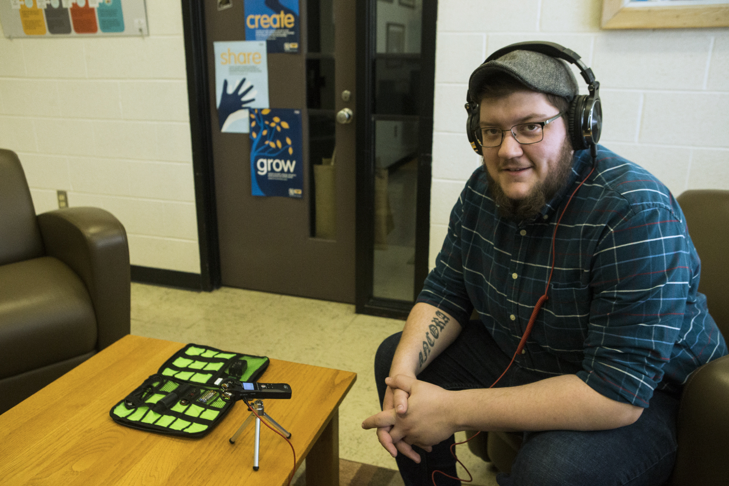 Graduate student Aiden Bettine with a Trans Oral History kit at the UI Main Library on April 29, 2019. The kits are distributed to various locations in Iowa so that transgendered/nonbinary individuals can record their stories.