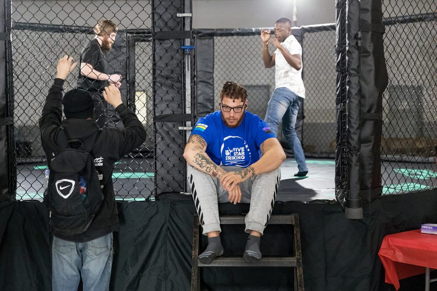MMA+fighter+Darion+Abbey+collects+his+thoughts+while+fighters+warm+up+in+the+cage+before+Elite+Fight+League+no.+4+at+the+Teamsters+Union+Hall+in+Cedar+Rapids+on+Saturday%2C+Apr.+13%2C+2019.+