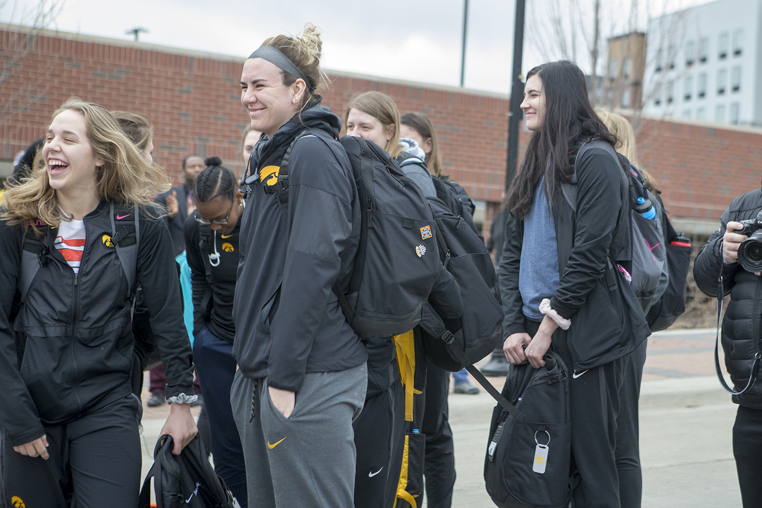 Teammates laugh as others depart the bus at the Transit Center on April 2, 2019.