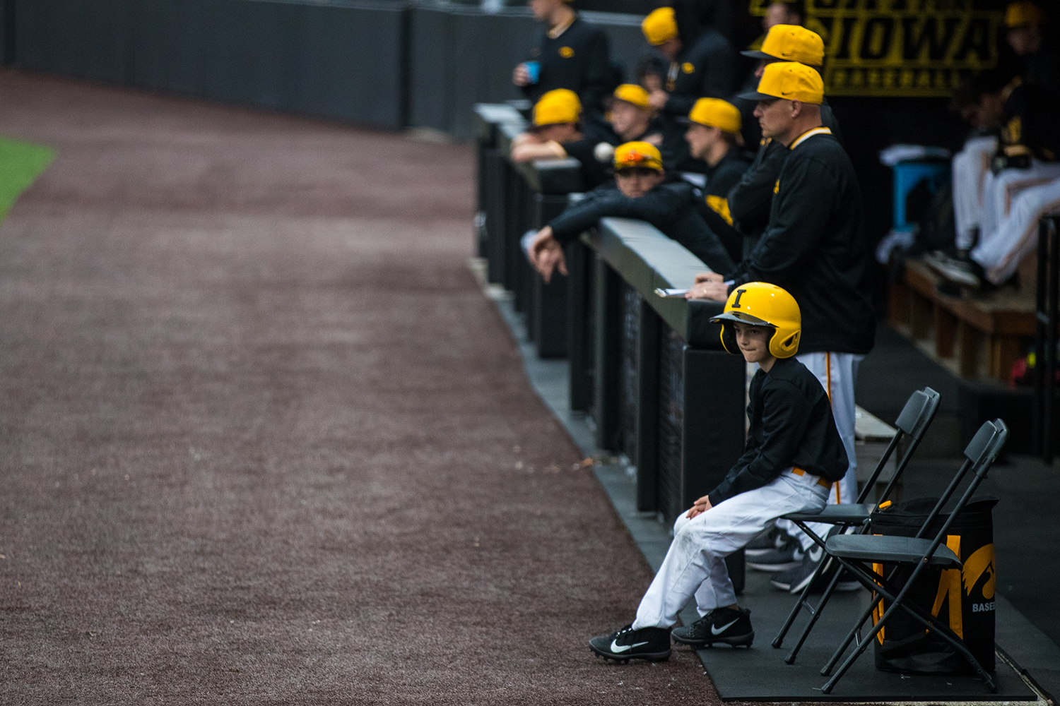 An+Iowan+ball+boy+watches++players+hitting+the+ball+during+a+baseball+game+against+Illinois+State+on+Wednesday%2C+Apr.+3%2C+2019.+The+Hawkeyes+lost+to+the+Redbirds+11-6.+%28Roman+Slabach%2FThe+Daily+Iowan%29