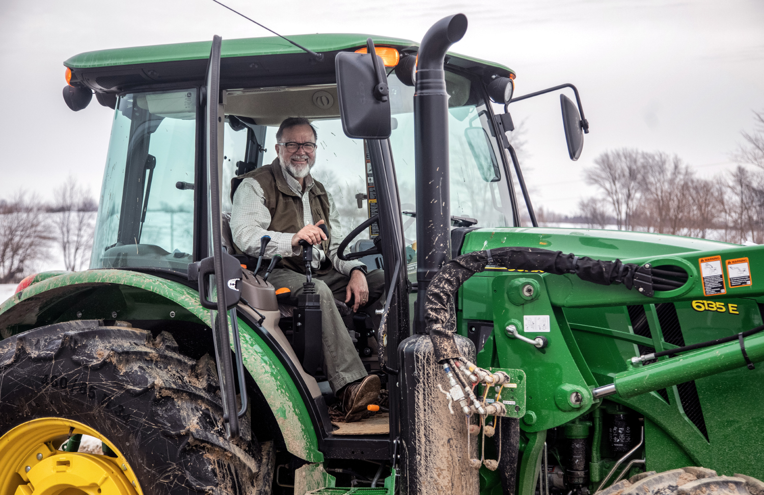 Bob Walker poses for a picture in his tractor while clearing the driveway to his farm on Friday, March 1.