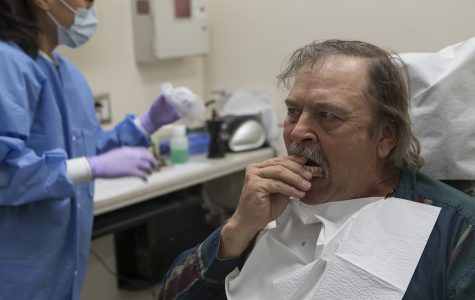 University of Iowa gives six veterans new dentures