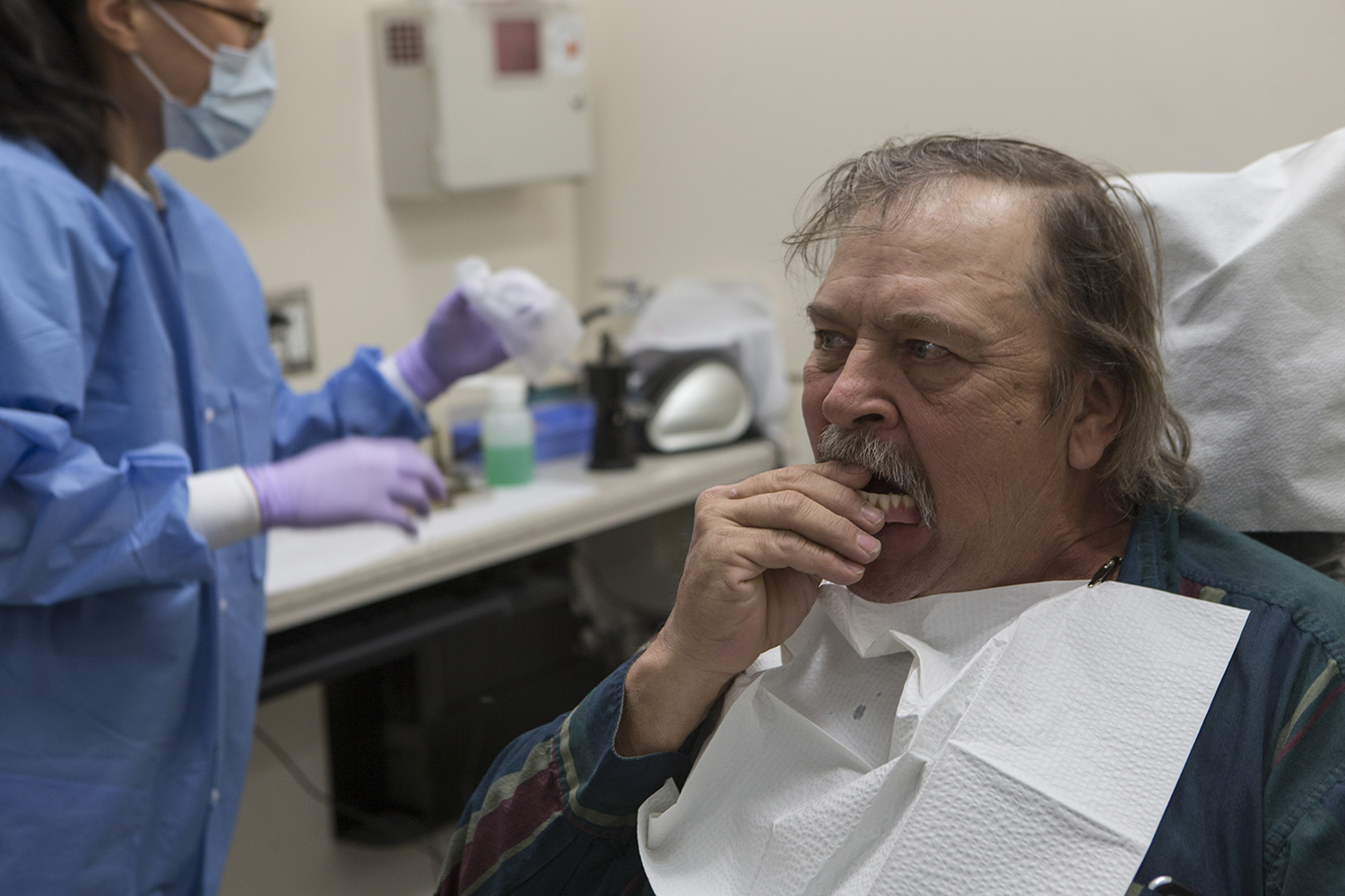 Steve Myers receives dentures from Dr. Hyunok Jo in the College of Denistry on April 11, 2019. The College of Dentistry has been giving free dentures to veterans in the community. A regular set of dentures is around $2500 and are typically not covered by dental insurance through the VA.