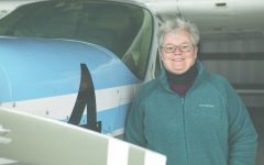 University of Iowa professor Minetta Gardinier poses for a picture next to the 1978 Cessna Cardinal at the Iowa City Municipal Airport on Wednesday, April 10. Gardinier races the Cessna in the United States and Canada.