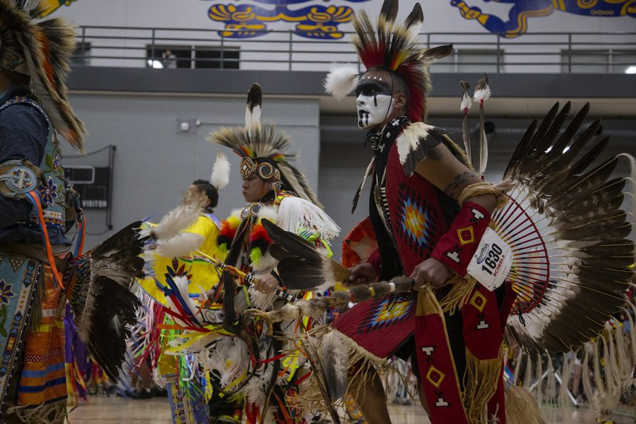 Dancers perform in the grand entrance during the 25th annual University of Iowa Powwow in the Fieldhouse on April 20, 2019. Hosted by the Native American Student Association, participants could buy traditional food and clothing, and sign up to perform traditional song and dance.
