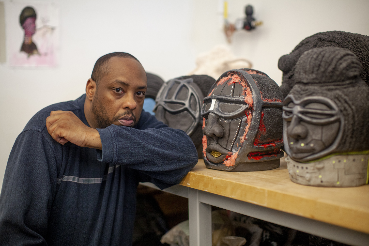 University of Iowa ceramics graduate student Donté K. Hayes poses for a portrait in his studio on Wednesday, April 24, 2019. During the event, students presented projects that combined art and engineering.