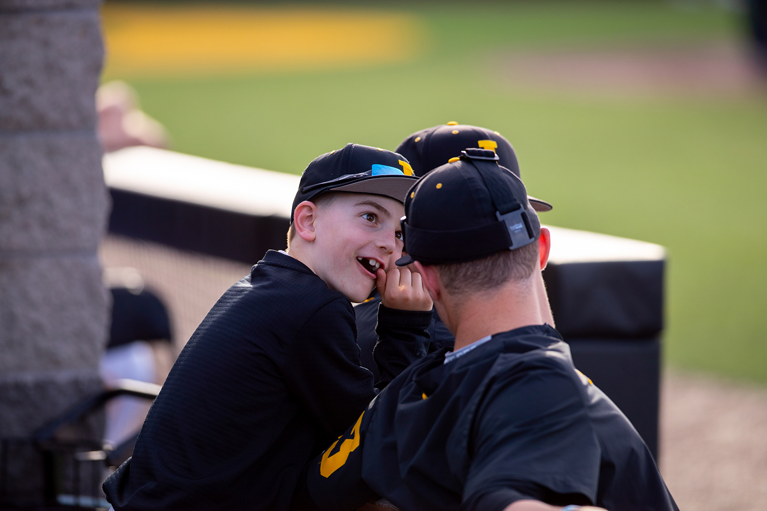 A+child+in+the+Iowa+dugout+jokes+around+with+the+team+during+the+baseball+game+against+Milwaukee+at+Duane+Banks+Field+on+Tuesday%2C+April+23%2C+2019.+The+Hawkeyes+defeated+the+Panthers+5-4.
