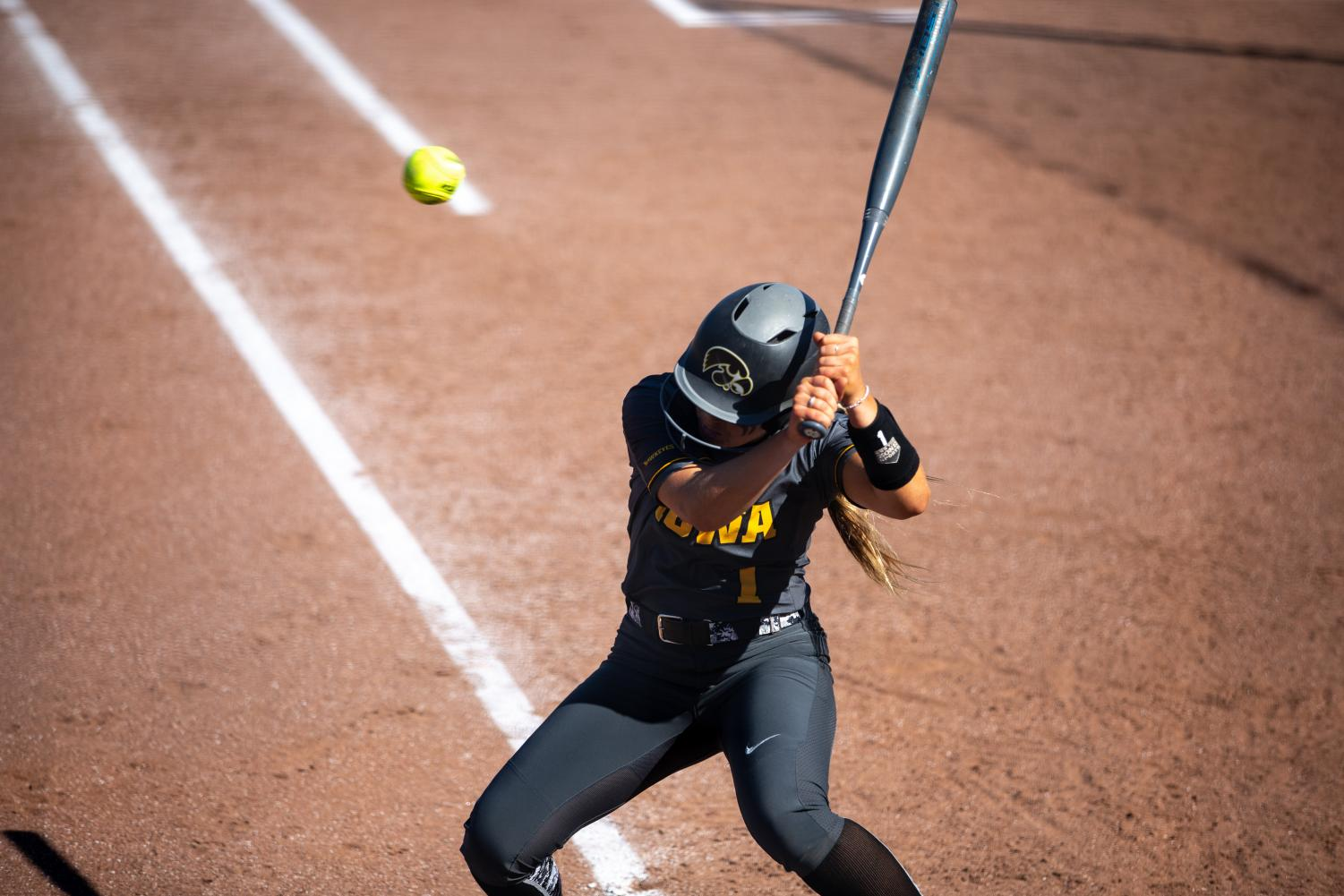 Iowa+infielder+Cameron+Cecil+avoids+a+ball+to+the+head+during+the+game+against+Nebraska+at+the+Bob+Pearl+Softball+Field+on+Wednesday%2C+April+24%2C+2019.+The+Hawkeyes+were+defeated+7-5+by+the+Huskers.+