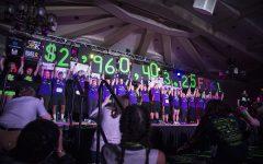Dancers celebrate reaching $2,960,403.25 during Dance Marathon 25 at the Iowa Memorial Union on Saturday, February 2, 2019.