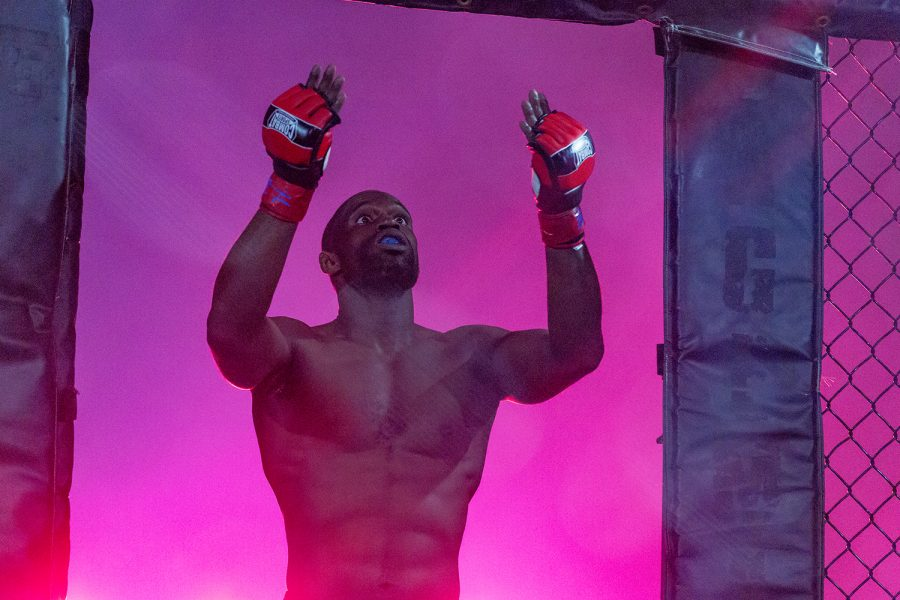 MMA fighter Jay Ellis focuses himself as he enters the cage during Elite Fight League no. 4 at the Teamsters Union Hall in Cedar Rapids on Saturday, Apr. 13, 2019.