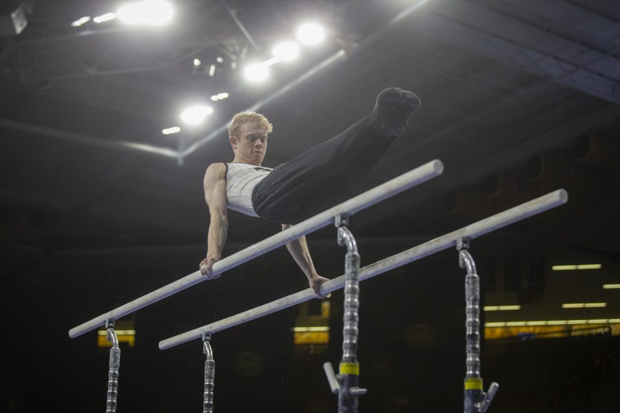 Nick+Merryman+gets+ready+to+compete+on+the+parallel+bars+during+day+two+of+the+Big+Ten+Men%27s+Gymnastics+Championships+in+Carver-Hawkeye+Arena+on+April+6%2C+2019.+Gymnasts+competed+in+individual+competitions.+Merryman+placed+36th+overall+with+a+score+of+13.600+on+the+parallel+bars.