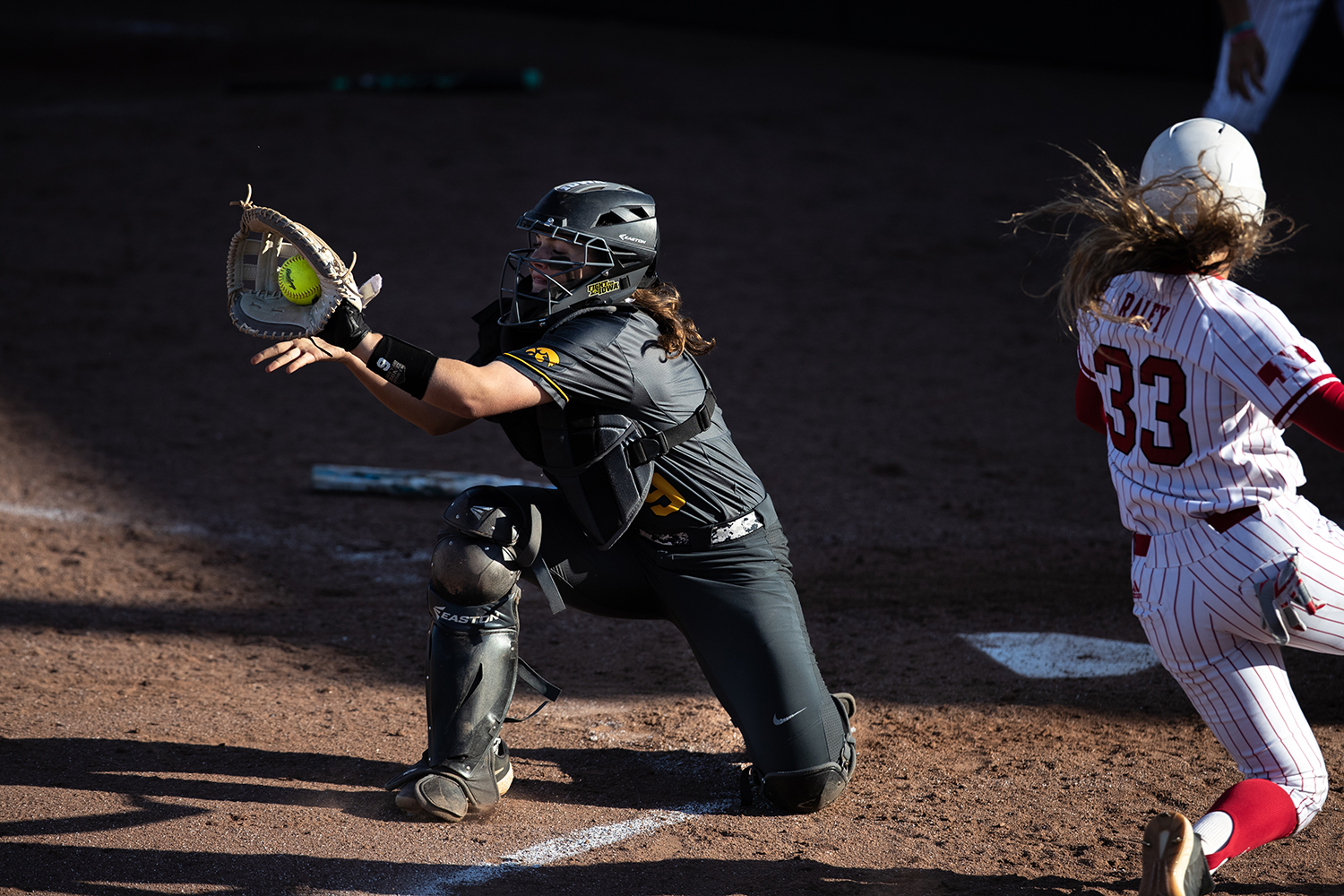 Iowa catcher Abby Lien catches a ball during the game against Nebraska at the Bob Pearl Softball Field on Wednesday, April 24, 2019.