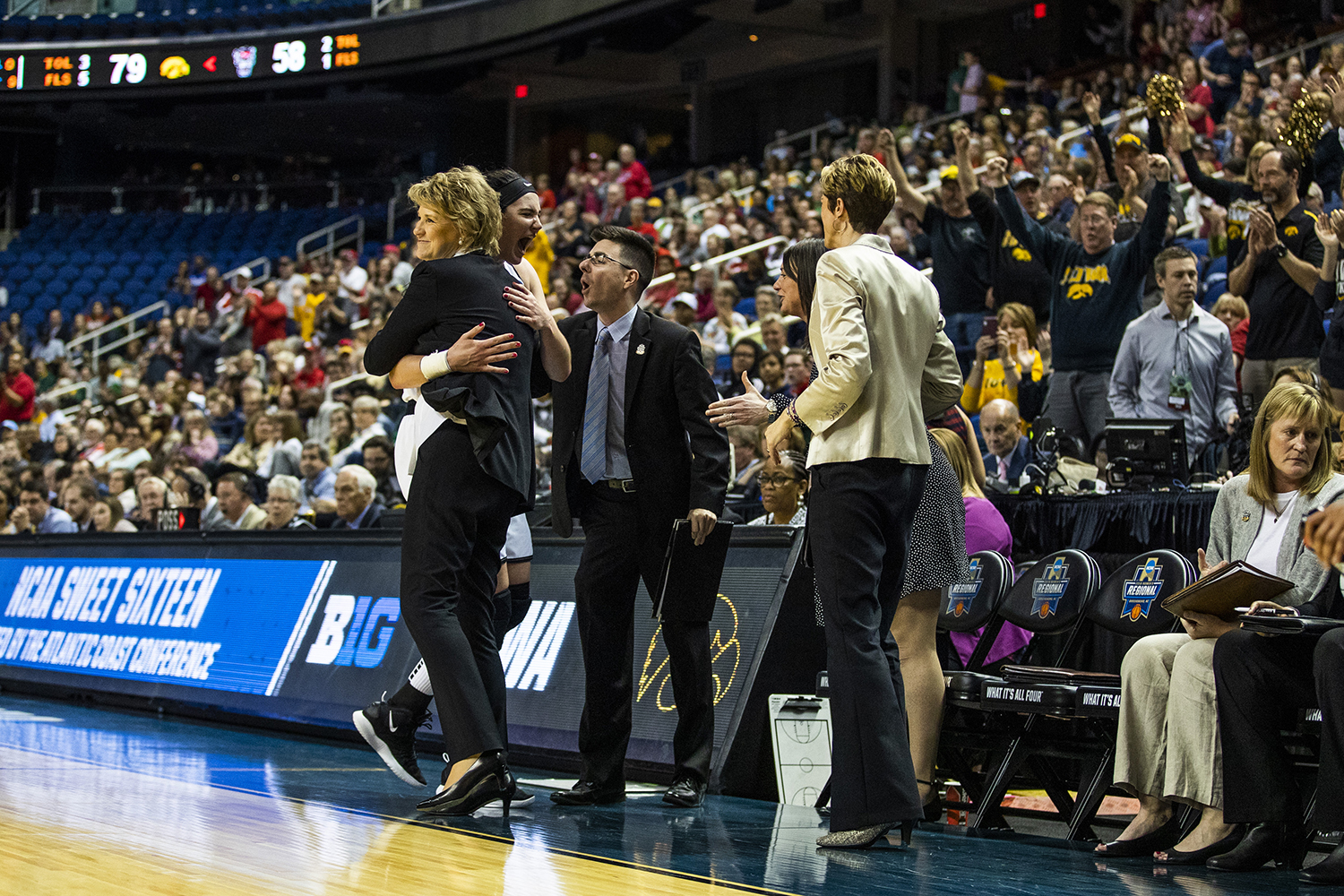 Iowa center Megan Gustafson hugs head coach Lisa Bluder after the win against NC State in the NCAA Sweet 16 game at the Greensboro Coliseum Complex on Saturday, March 30, 2019. The Hawkeyes defeated the Wolfpack 79-61.