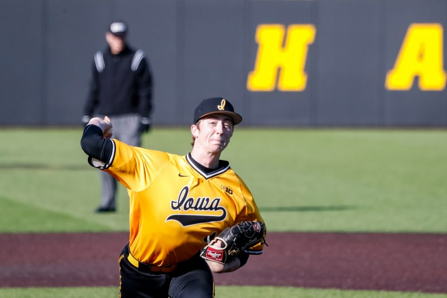 Iowas Duncan Davitt pitches the ball during a baseball game against Clarke University on Tuesday, Apr. 2, 2019. The Hawkeyes defeated the Pride 3-2.