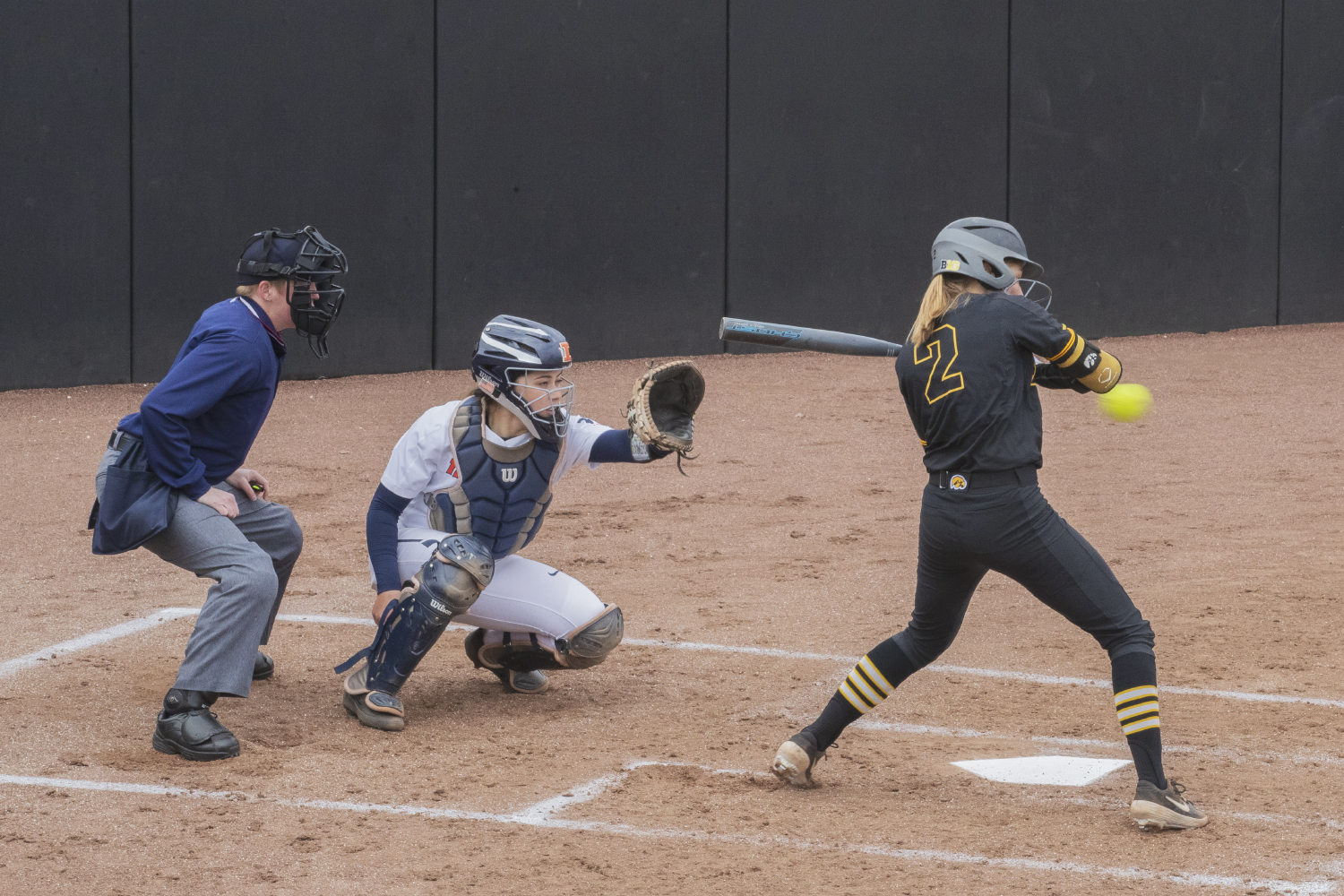 Iowa utility Aralee Bogar watches a pitch during the first game in a double header against Illinois on Saturday, April 13, 2019. Bogar got a walk to first. The Hawkeyes fell to the Illinis 12-11 but came back to win the second game.