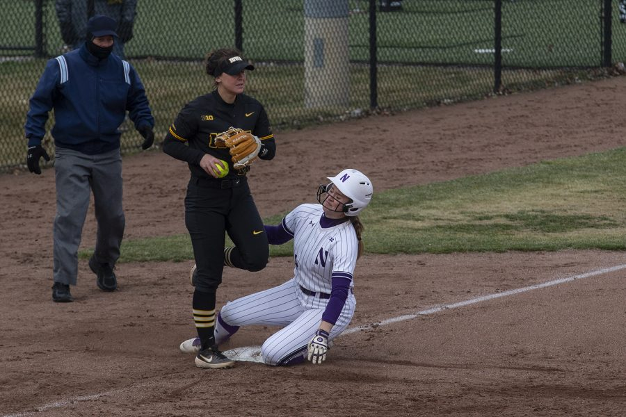 Pitcher/utility Mallory Kilian gets Maeve Nelson out on third during softball against Northwestern on Bob Pearl Field on March 30, 2019. The Wildcats defeated the Hawkeyes 6-2 after the 7th inning.(Katie Goodale/The Daily Iowan)