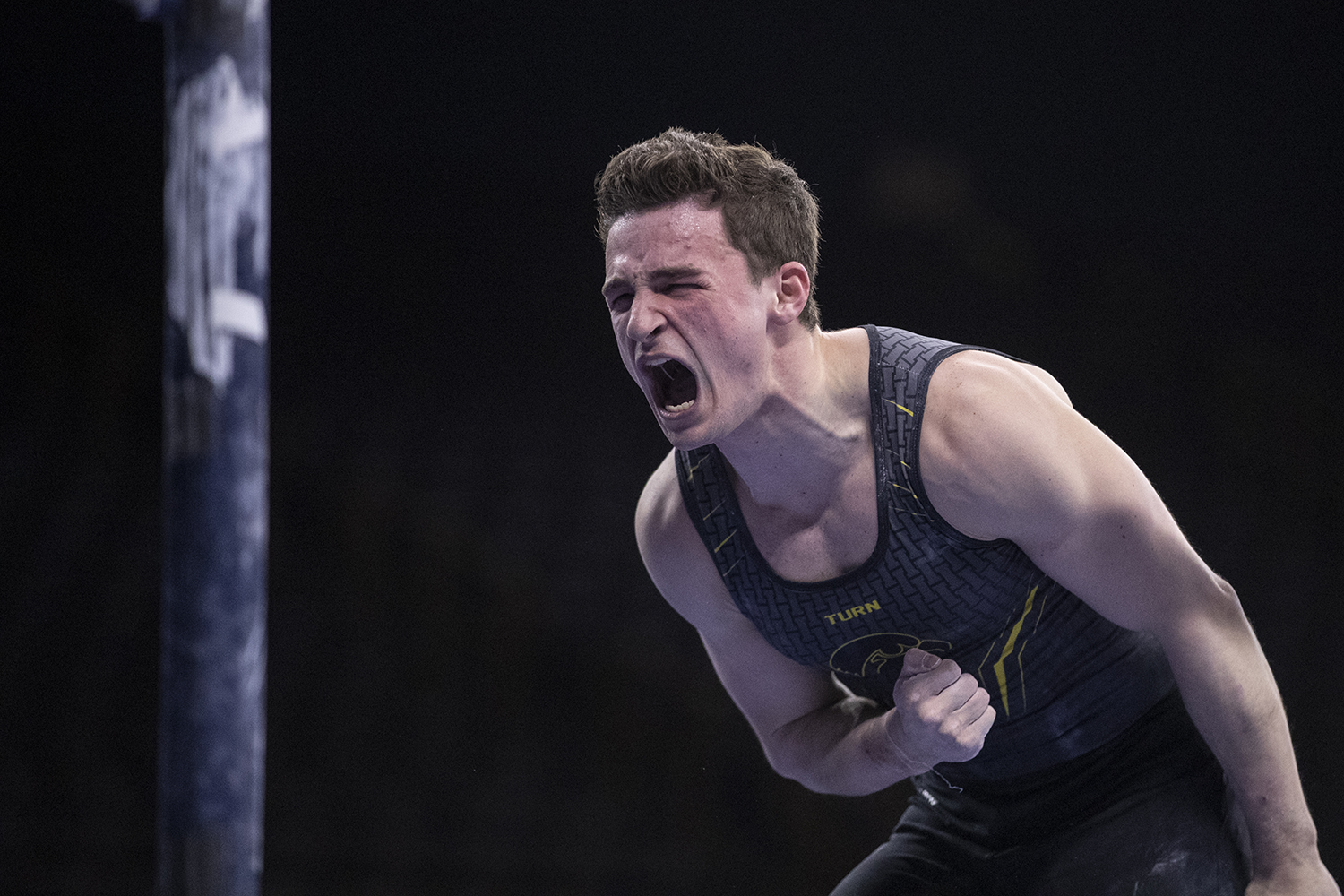 Hawkeye gymnast Jake Brodarzon celebrates after competing in the parallel bars Friday in Carver Hawkeye Arena during the Men's Big Ten Championships. Penn State won the team competition with a combined score of 410.350 points.