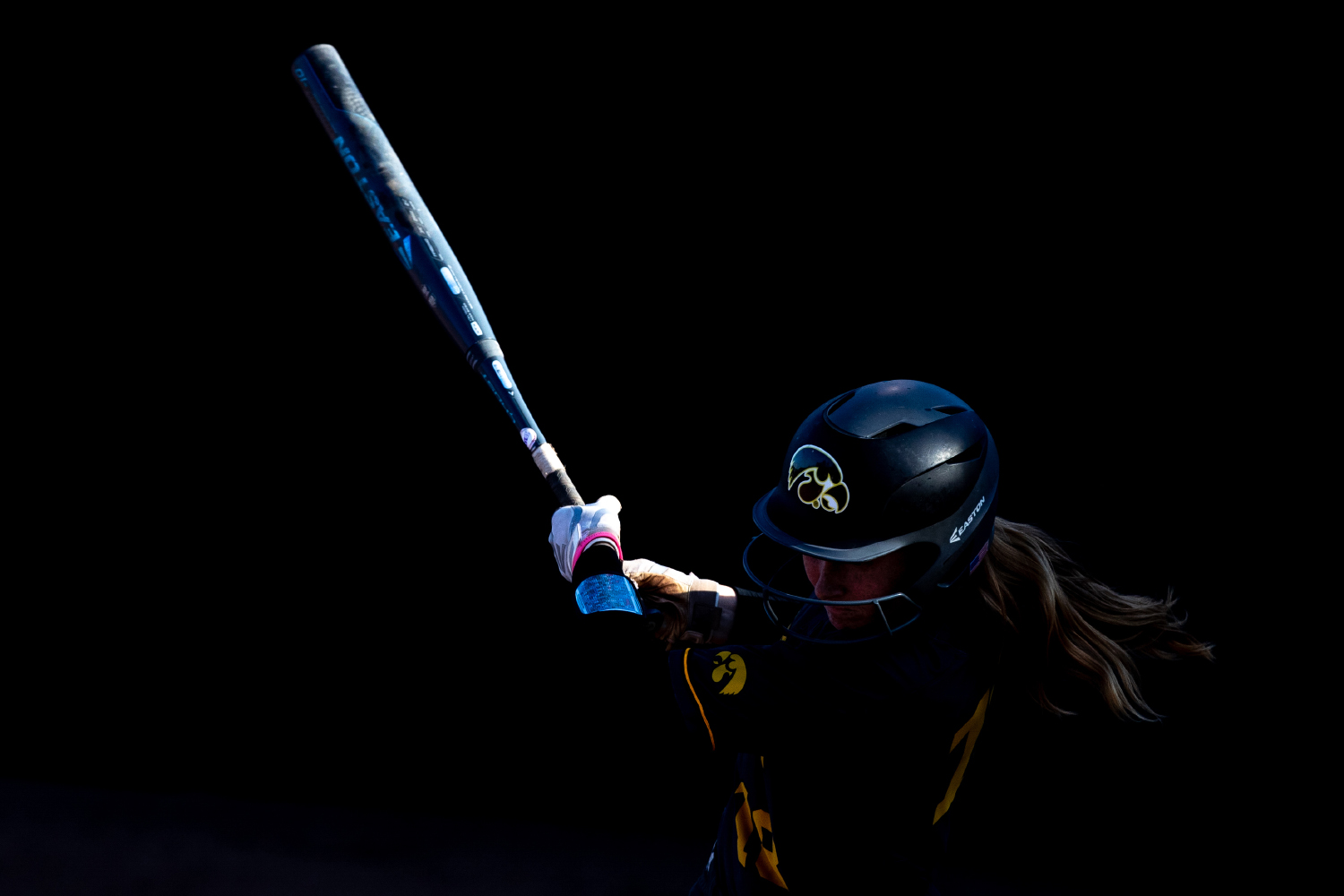 Iowa utility player Ashley Hamilton misses the ball during the game against Nebraska at the Bob Pearl Softball Field on Wednesday, April 24, 2019. The Hawkeyes were defeated 7-5 by the Huskers.