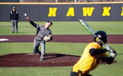 Clarke pitcher Tsubasa Maruyama pitches the ball to Iowa's Brendan Sher during a baseball game against the University of Iowa on Sunday, Mar. 31, 2019. The Hawkeyes defeated the Pride 3-2.