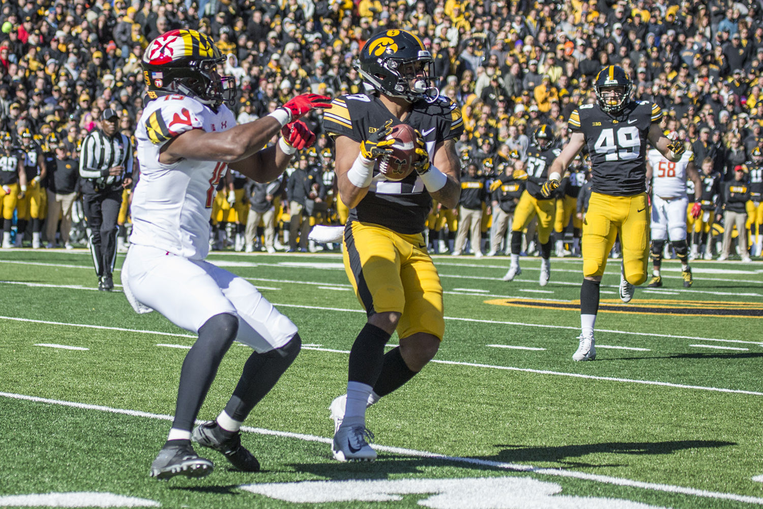 Iowa defensive back Amani Hooker intercepts a Maryland pass during a football game between Iowa and Maryland in Kinnick Stadium on Saturday, October 20, 2018. The Hawkeyes defeated the Terrapins, 23-0.