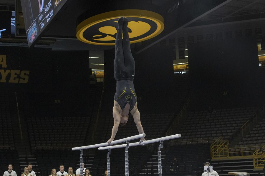 Stewart+Brown+competes+on+parallel+bars+on+February+9%2C+2019+at+Carver+Hawkeye+Arena+vs.+Oklahoma+University.+The+Oklahoma+Sooners+won+the+meet+with+a+total+score+of+405.150+over+the+Hawkeyes+scoring+397.750.