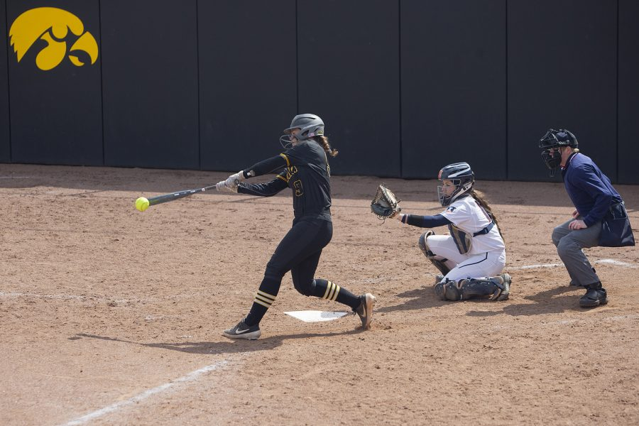 Iowa utility Abby Lien swings at a pitch during the the fourth inning of the first game in a double header against Illinois on Saturday, April 13, 2019. Lien popped up to right field. The Hawkeyes fell to the Illinis 12-11 but came back to win the second game.