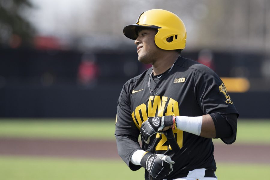 Iowa+infielder+Izaya+Fullard+takes+off+his+gloves+after+bunting+to+first+during+the+sixth+inning+of+the+afternoon+Iowa+vs+Rutgers+game+at+Duane+Banks+Field+on+Saturday%2C+April+7%2C+2019.+The+Hawkeyes+defeated+the+Scarlet+Knights+9-5.+
