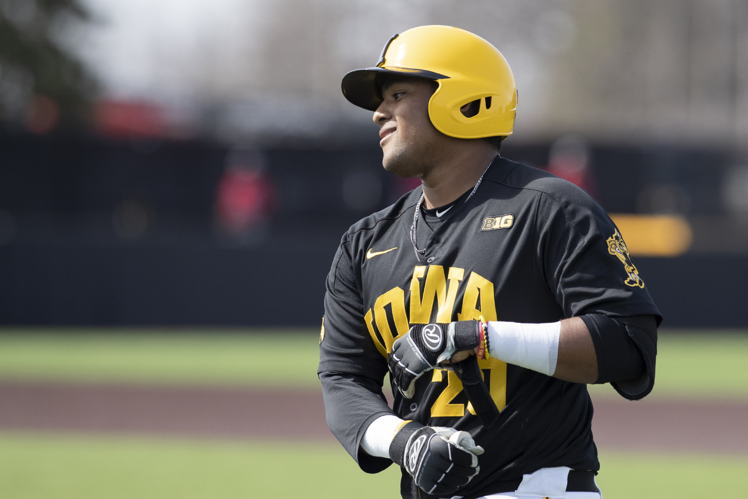 Iowa infielder Izaya Fullard takes off his gloves after bunting to first during the sixth inning of the afternoon Iowa vs Rutgers game at Duane Banks Field on Saturday, April 7, 2019. The Hawkeyes defeated the Scarlet Knights 9-5.
