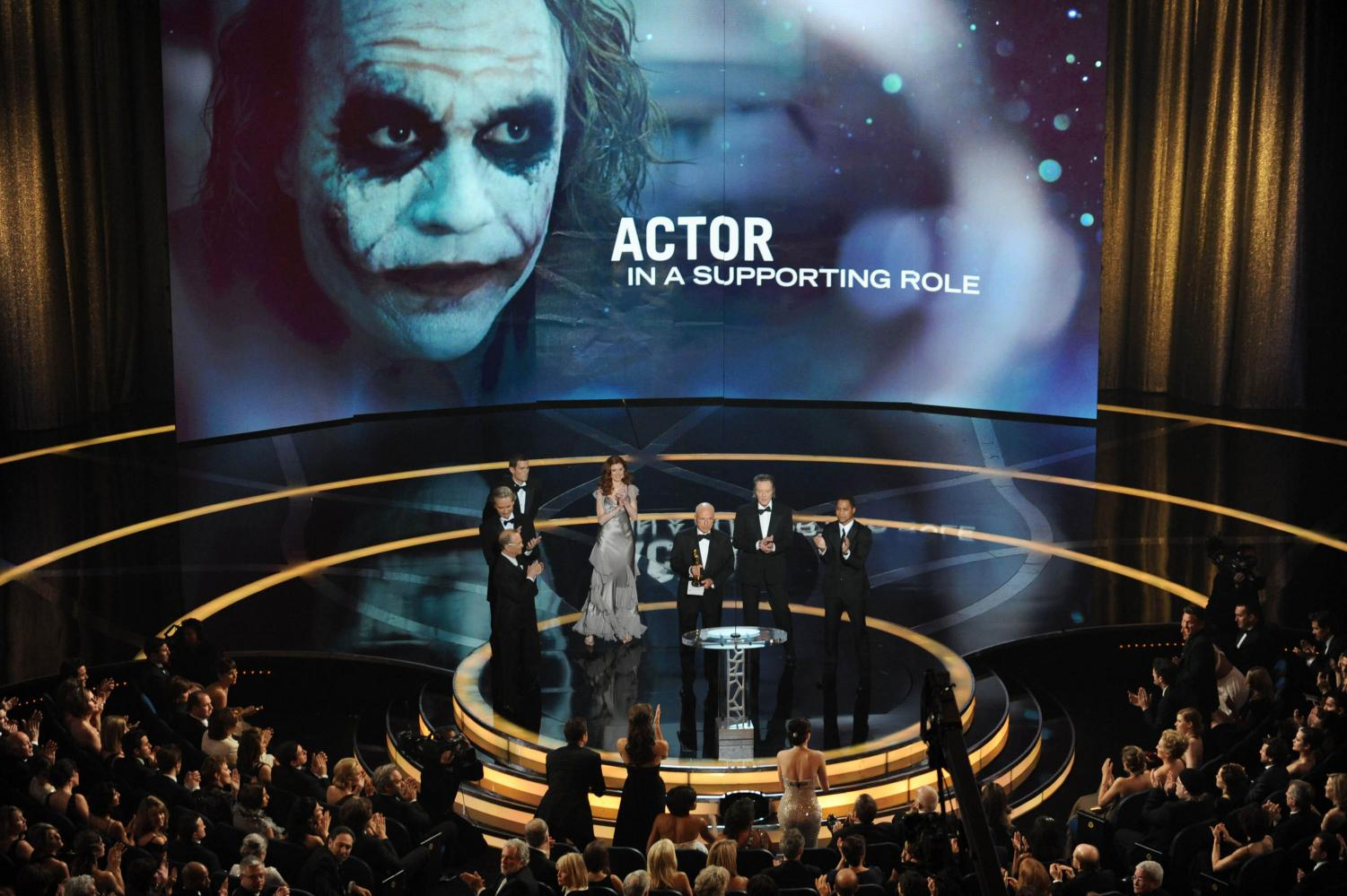 Heath Ledger's father Kim Ledger accepts the Oscar for best supporting actor on behalf of Heath Ledger who won for his work in