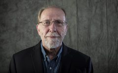 Representative Dave Loebsack stands for a portrait at the Daily Iowan newsroom on Sunday, September 23, 2018.