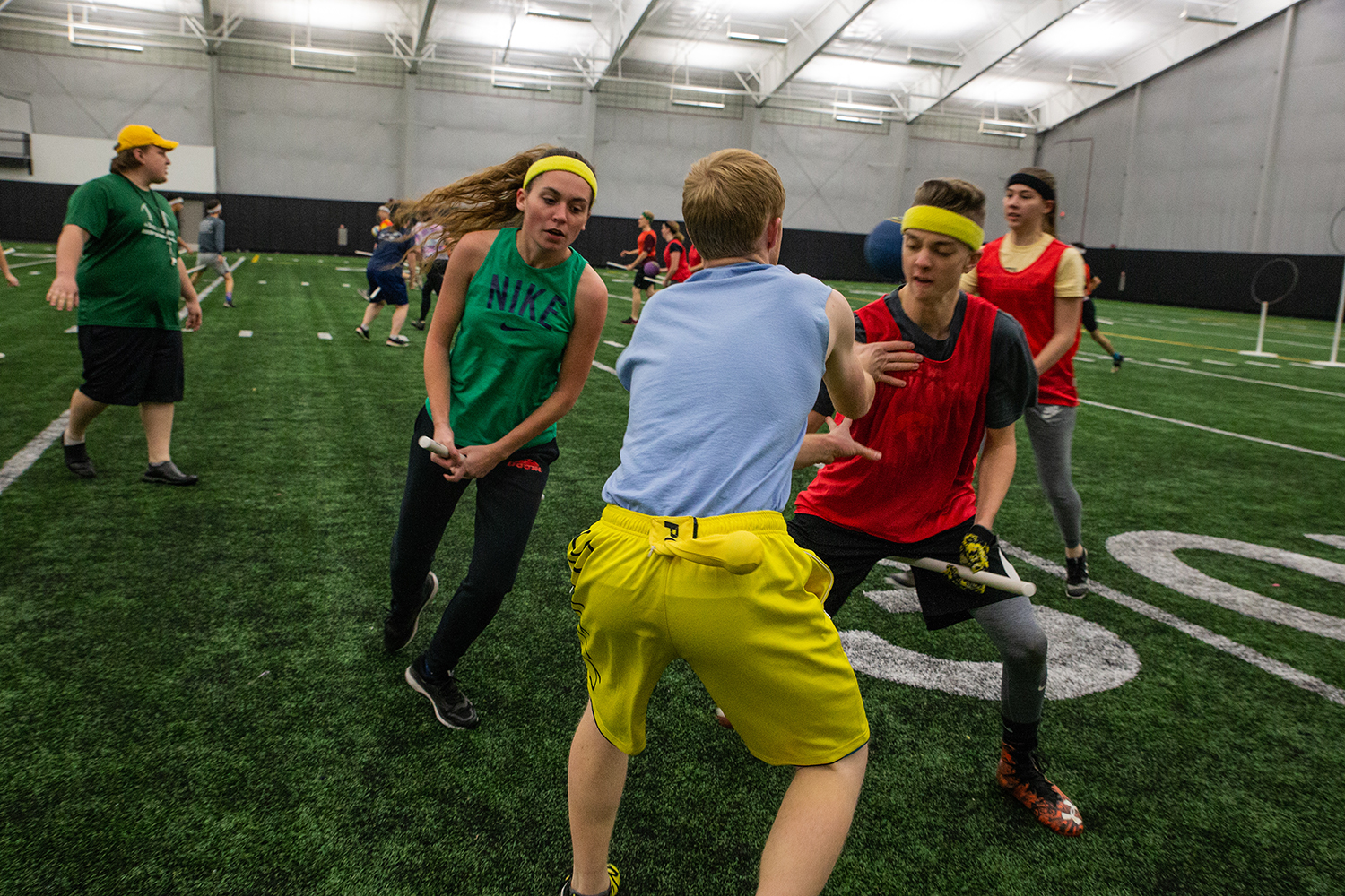 University of Iowa Club Quidditch players chase the golden snitch during an intersquad scrimmage at the Hawkeye Tennis and Recreation Complex on Wednesday, November 14, 2018.