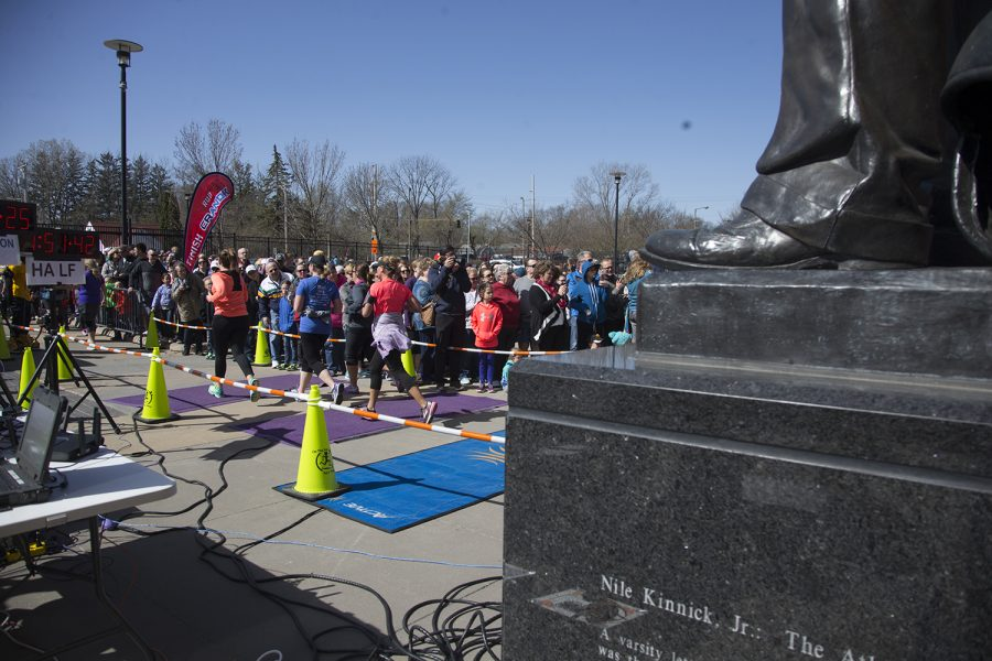 Runners+approach+the+finish+line+during+the+River+Run+marathon+at+Kinnick+Stadium+on+Sunday+Apr.+29%2C+2018.+Runners+participated+in+a+5K+beginning+at+Northwest+Junior+High+School+in+Coralville+and+ending+by+Kinnick%2C+where+runners+could+get+refreshments+and+visit+the+field.+