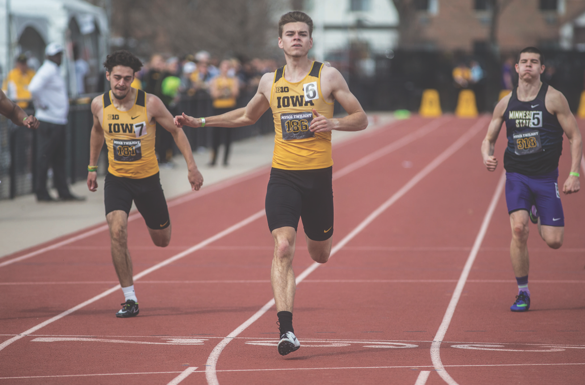 Iowa's Chris Douglas finishes first in the 200 meters during the 19th-annual Musco Twilight meet at the Cretzmeyer Track on April 12, 2018.