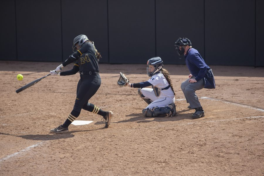 Iowa infielder Donirae Mayhew lines up to hit the ball during the first game in a double header against Illinois on Saturday, April 13, 2019. Mayhew hit a home run. The Hawkeyes fell to the Illinis 12-11 but came back to win the second game. (Jenna Galligan/The Daily Iowan)